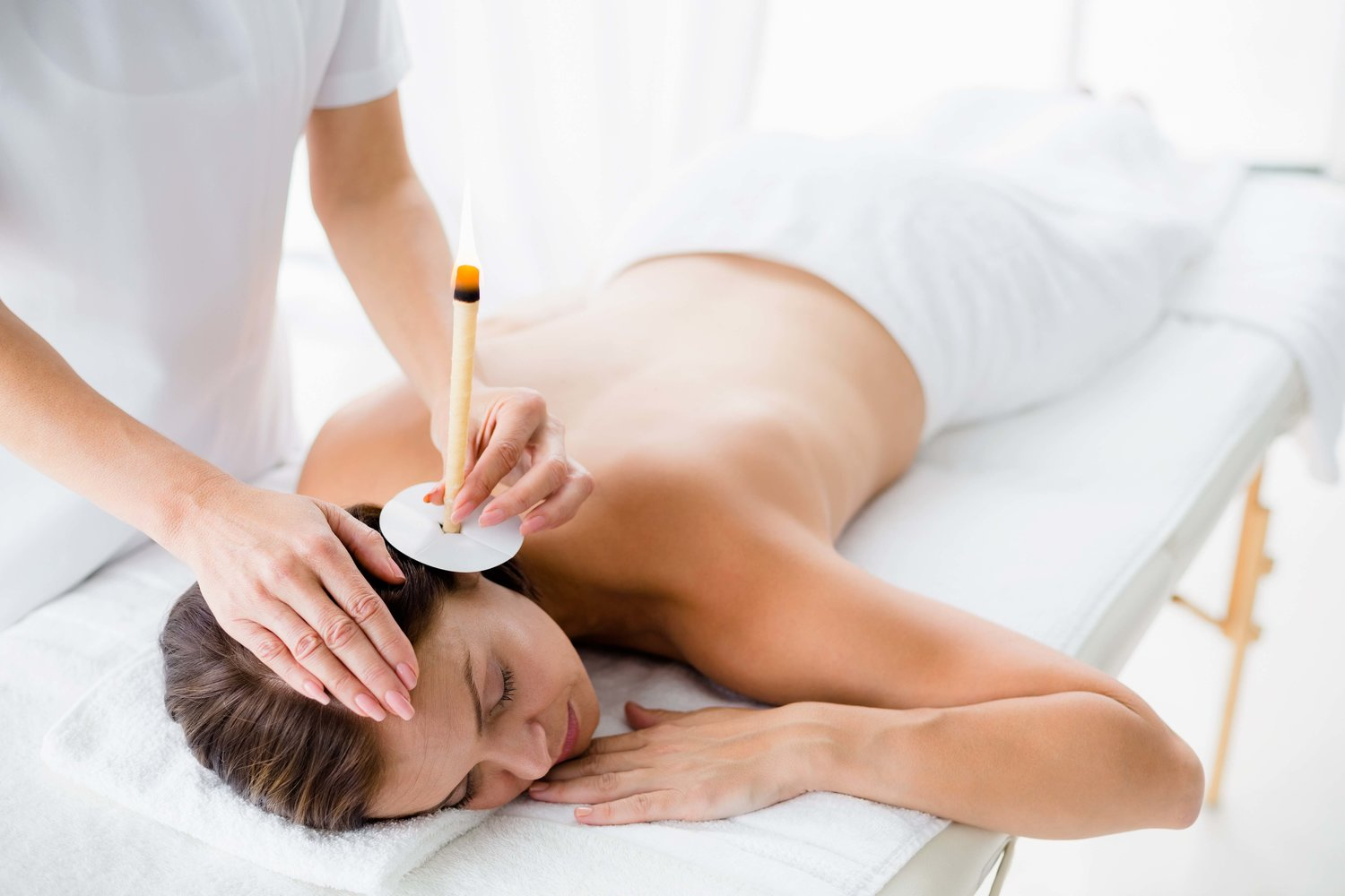 EAR CANDLING (THERMAL-AURICULAR THERAPY)